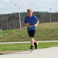 Young Runner During Race