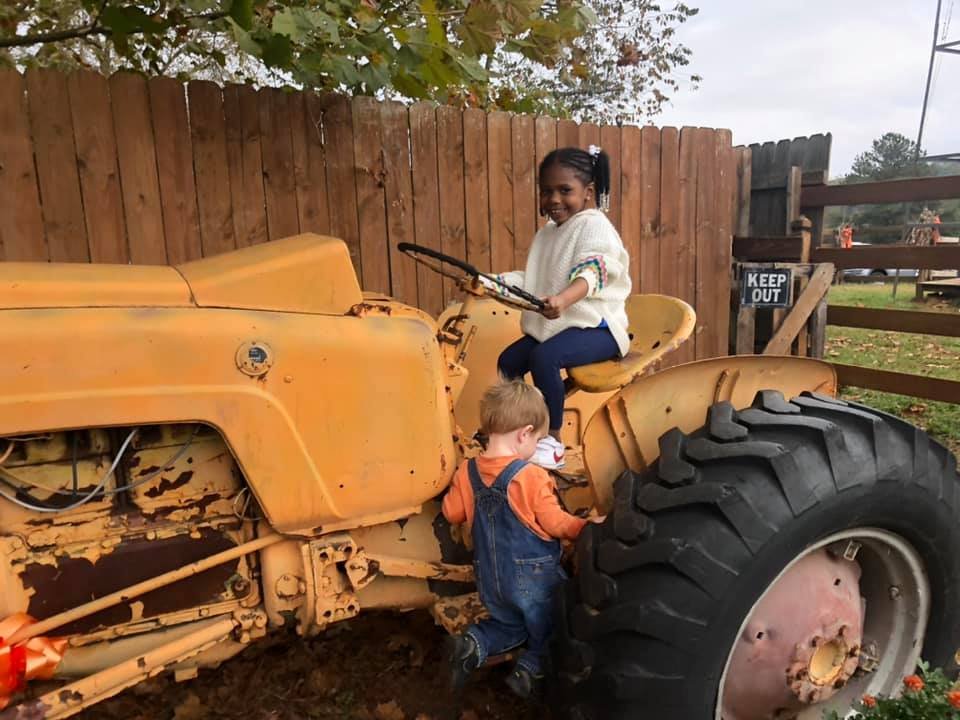 kid on tractor