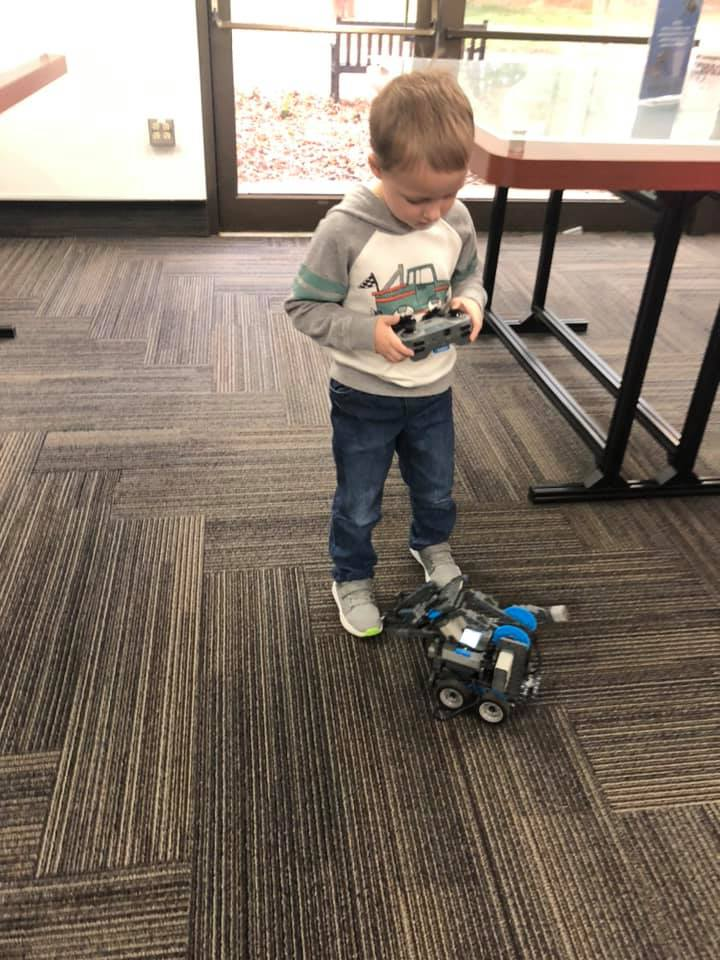 kid playing with remote control car