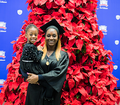 Photo of University of West Georgia graduate Yeme Thomas and her daughter.