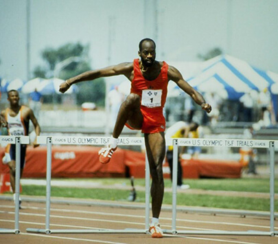 Vintage photo of Olympian Edwin Moses participating in a track event