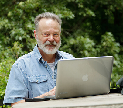 Photo of University of West Georgia College of Education doctoral student at a computer