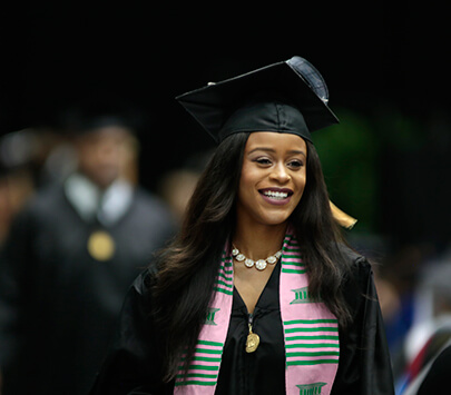 Photo of African-American graduate walking the stage at a University of West Georgia commencement ceremony