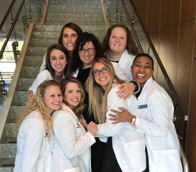 Photo of University of West Georgia Tanner Health System School of Nursing student Tammy White surrounded by her classmates