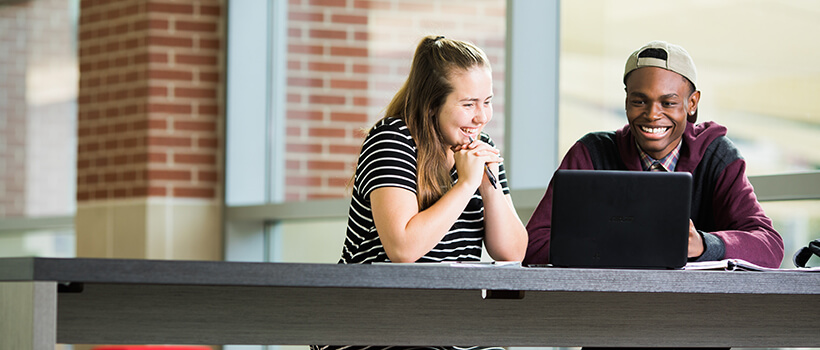 Photo of two University of West Georgia students on a laptop