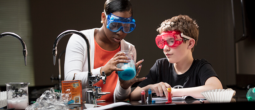 Teacher and student with science experiment