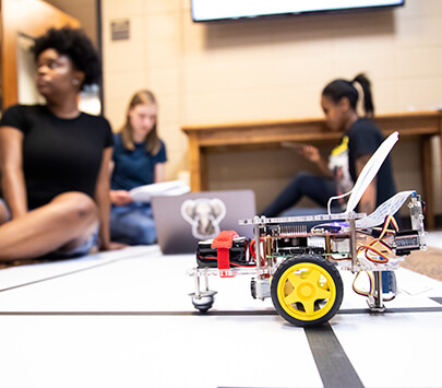 UWG students play with a robot