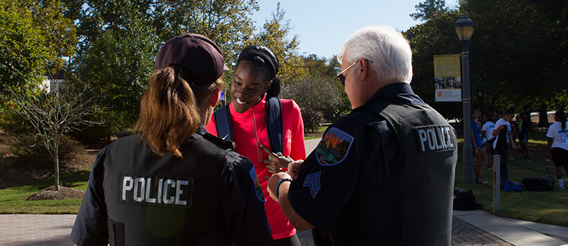 UWG student smiles with police officers