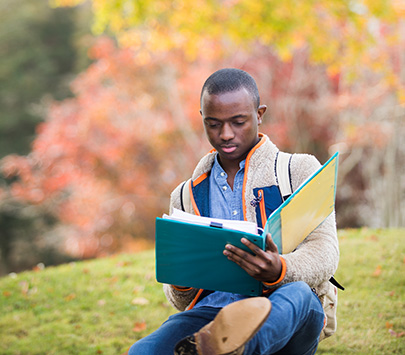 A student studying outside on UWG's campus