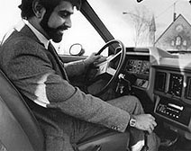 Dr. Beheruz N. Sethna demonstrating an electric powered vehicle during the 1980s.