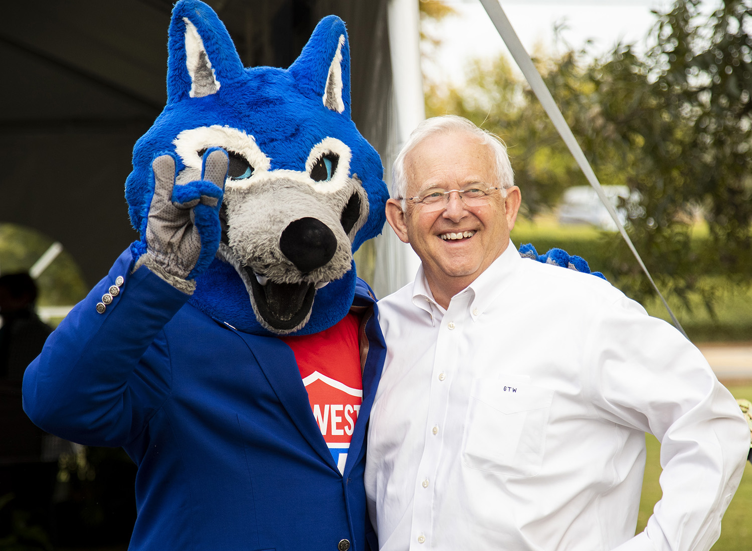 Wolfie with local business owner