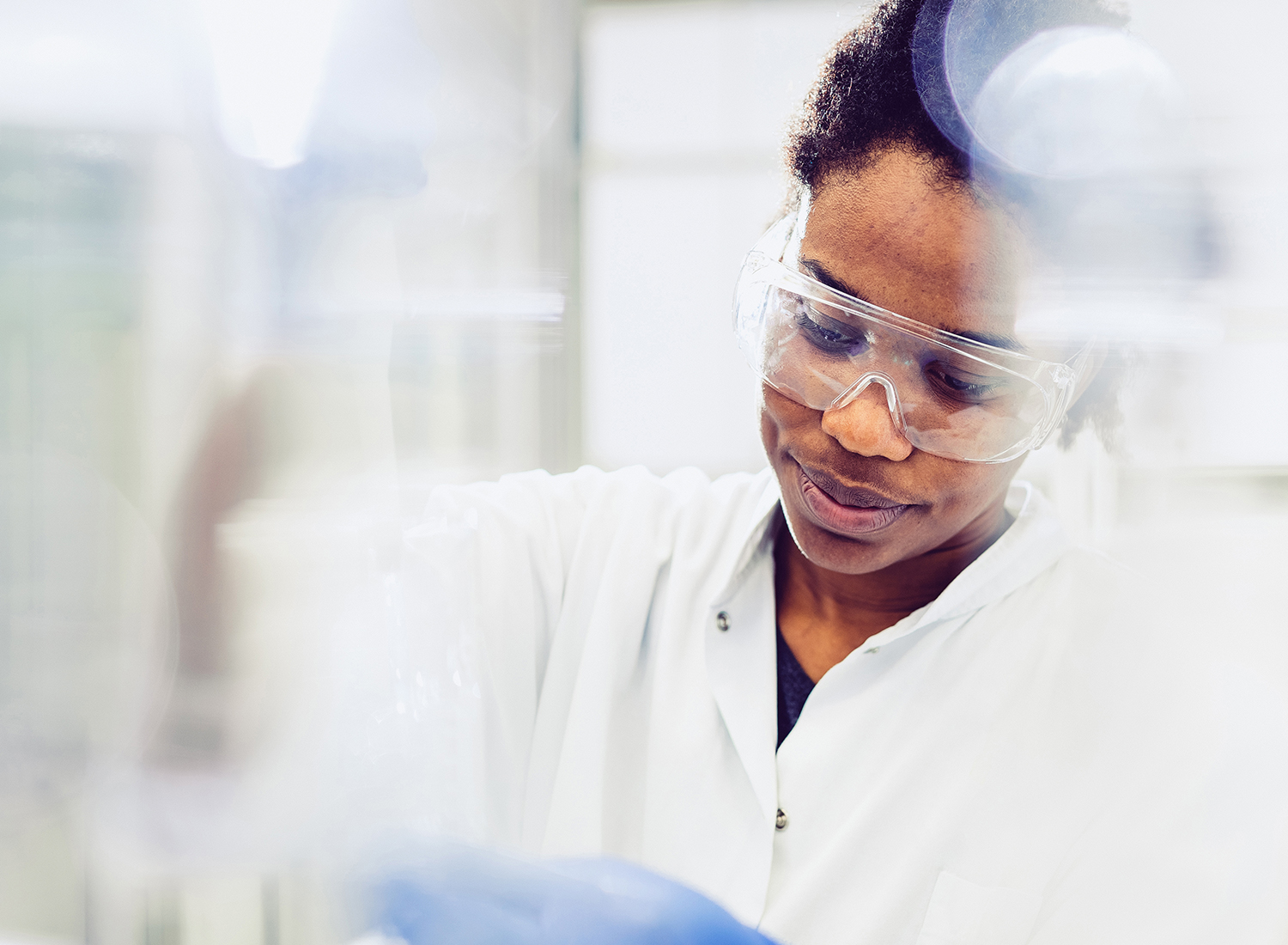 Female college student working in a lab.
