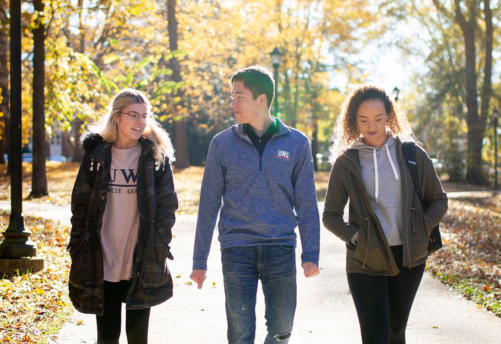 Three UWG students walking outside.