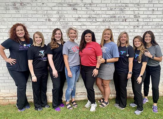 (L - R) Brittany Sleek, Brandi Parker, Tori Smith, Erika Smith, Dr. Allison Key, Sarah Grace Smith, Chasity Brock, Brianna Ricker, Sarah Sprayberry. Photo Credit: Gabby Liles.