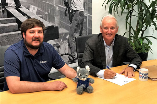 Albion Executive Vice President, Brian Newsome (right), signs off on an endowed scholarship for the University of West Georgia with Jason Strane, project manager.