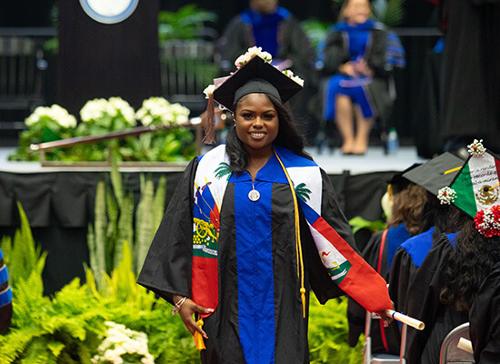 Graduate walking at commencement