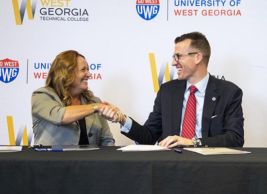 Dr. Julie Post and Dr. Brendan Kelly shake hands