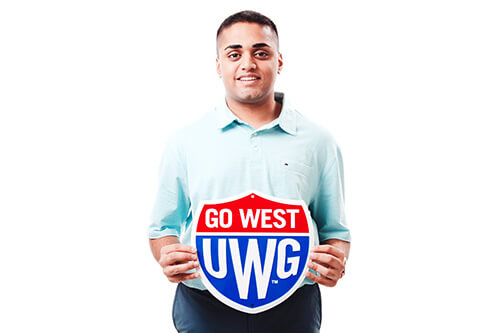 Bhavin Patel holding up a Go West shield