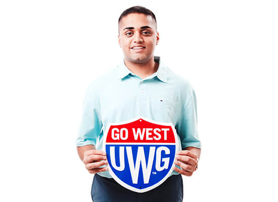 Bhavin Patel holding a Go West shield
