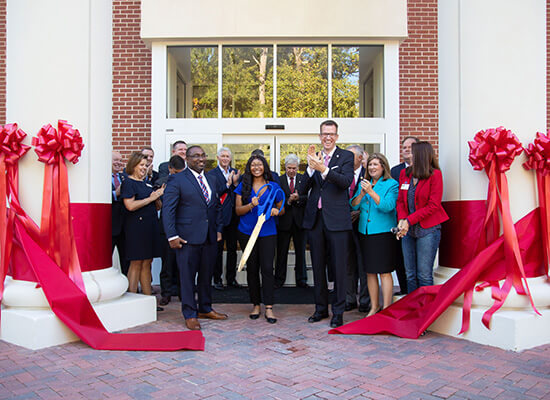 Dr. Brendan Kelly and others at UWG's ribbon-cutting ceremony for Richards Hall.