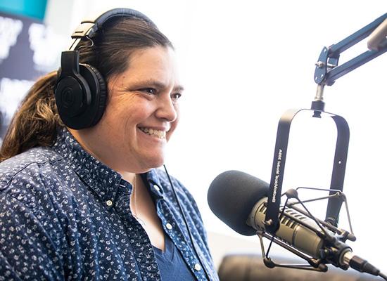 Dr. Sarah Jones at a microphone