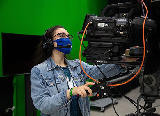 Student at a video camera
