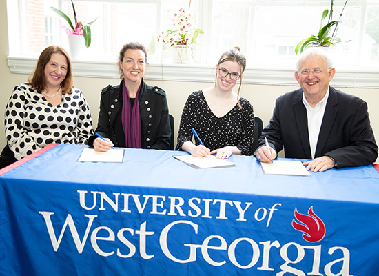 Pictured from left to right: UWG Ingram Library Dean Andrea Stanfield, UWG Head of Special Collections & Associate Professor Blynne Olivieri, Newnan-Coweta Historical Society Director Emily Kimbell, Newnan-Coweta Historical Society Board President Gary Welden