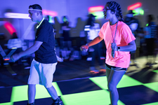 Two students skating at Glow Skate event
