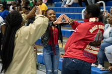 Members of Delta Sigma Theta Sorority, Incorporated enjoying the annual Homecoming Stroll-Off