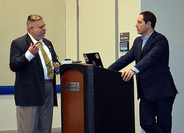 Mardel Shumake speaks with SecureWork's Taylor Murphy at a podium