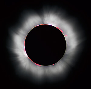 Total solar eclipse depicting corona.