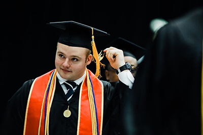 Jacob Sudduth turns his tassel at graduation.