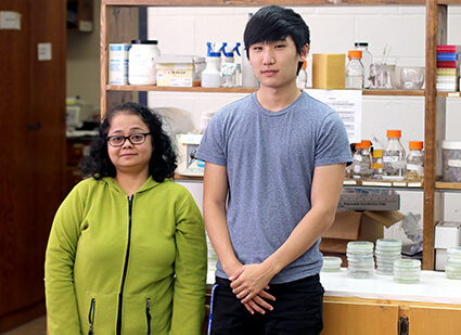 University of West Georgia biology student Kenneth Kim with Dr. Mautusi Mitra in the Mitra Lab.