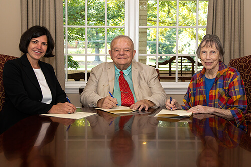 L to R: Ketty Cusick, director of development; Dr. Bob Powell, professor emeritus; Betty Ballard Powell