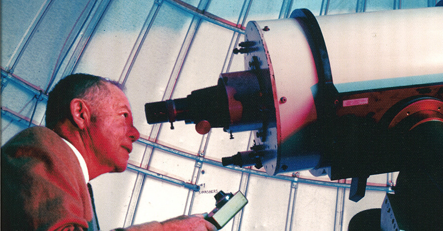 Dr. Bob Powell looks through a reflector telescope with approximately 16 inch aperture at the University of West Georgia Observatory.