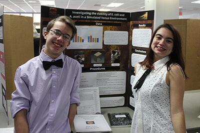 Nick Gorzynski, Blair Cowan attend their poster presentation, Investigating the Viability of E. coli and A. aceti in Simulated Venus Environment