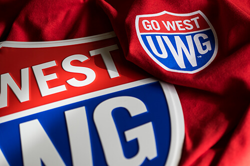 UWG Go West shield and shirt