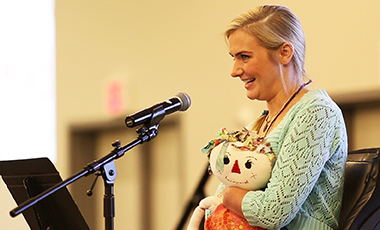 Aimee Copeland was a graduate student at the University of West Georgia in 2012 when she fell from a homemade zip line and contracted necrotizing fasciitis, a deadly disease that claimed both arms below the elbow, her right leg below the knee, and her left leg almost to her hip. She recently returned West to share her nothing-short-of-miraculous story of survival and perseverance with faculty and staff, some who were with her during those touch-and-go moments . . . as well as some lessons she's learned along the way.