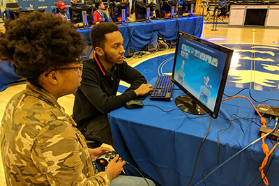 A female UWG student chooses her character during a video game competition