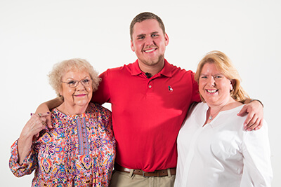 Taylor Smith with his mom and grandmother