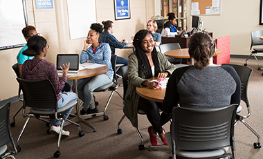 Students talking in an academic setting