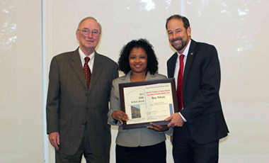 Chancellor Henry M. Huckaby and Georgia Historical Records Advisory Council (GHRAC) Chair P. Toby Graham presented the Center for Public History at the University of West Georgia and UWG alumna Tonya McNealey with awards during the 14th annual GHRAC Archives Awards ceremony at the Georgia Archives on Wednesday, Oct. 26. The GHRAC Awards recognize outstanding efforts in archives and records work in Georgia.