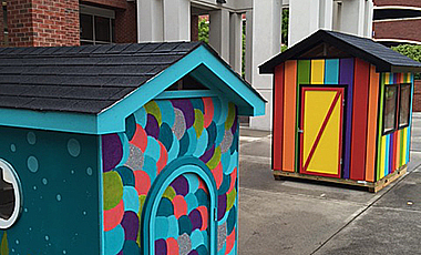 As part of a service project for literacy, University of West Georgia Ignite students have painted two playhouses that will be raffled this weekend to benefit the Carroll County Ferst Foundation for Childhood Literacy.