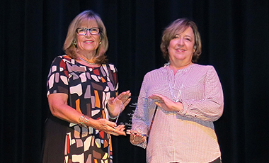 Dr. Melanie McClellan was named the 2016 Woman of the Year by the Carroll Chamber Women's Business Alliance at their recent luncheon at the Carrollton Cultural Arts Center. Paula Gillispie, the 2015 WBA Woman of the Year, introduced McClellan to the record crowd.