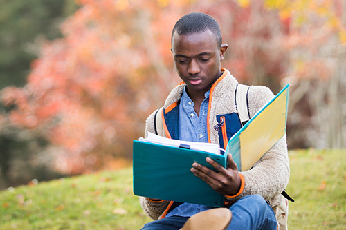 Student studying outside on UWG's campus