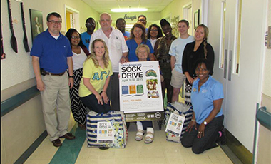 The University of West Georgia's Center for Diversity and Inclusion (CDI) recently held its fifth annual sock drive in celebration of Older Americans Month. Students, alumni, and CDI staff delivered a total of 813 socks to four nursing homes in Carrollton—Carrollton Manor, Carrollton Nursing and Rehabilitation, the Oaks of Carrollton, and Pine Knoll Nursing and Rehabilitation—and Haralson Nursing and Rehabilitation in Haralson County.