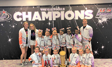 When Spencer Gist was a kid, he had a trampoline in his backyard. He'd flip and flop on it all day, not knowing then that the skills he was learning would enable him to coach a team of cheerleaders to a competitive national stage.