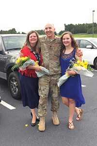 Photo of University of West Georgia employee and alumnus Jim Martin with his wife and daughter