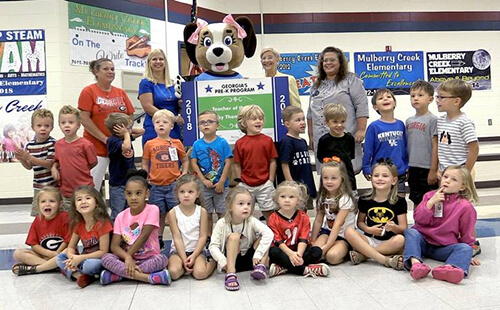 Becky Thomas Haden is pictured with Georgia first lady Sandra Deal and her students at Mulberry Creek Elementary School.