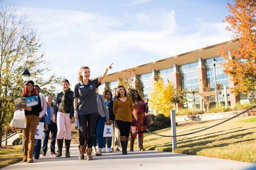 Students touring campus in the Fall